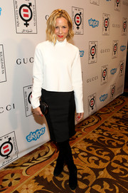 Maria Bello paired her top with a multitextured black pencil skirt for a modern monochrome look.