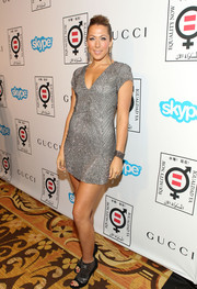 Colbie Caillat brought a bit of an edge to her outfit with a pair of silver and black open-toe ankle boots.