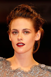 Kristen Stewart swiped on some red lipstick for a bold pop of color to her look.