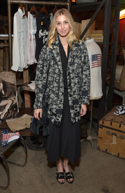 Whitney Port paired a black-and-white jacquard coat with an LBD for the launch of Erin Wasson's PacSun collection.