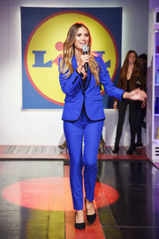 Heidi Klum looked sharp in an electric-blue pantsuit at the Esmara by Heidi Klum presentation.