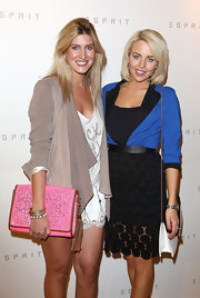 Francesca's fabulous neon pink laser-cut clutch was the stand-out piece of her store opening ensemble.