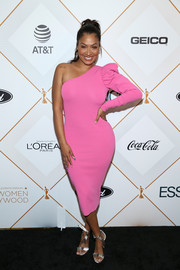 La La Anthony added a dose of shine with a pair of silver knot-detail sandals.