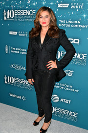 Tina Knowles opted for an embroidered pantsuit when she attended the Essence Black Women in Hollywood Awards.