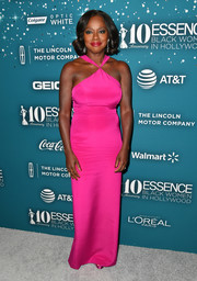 Viola Davis brightened up the gray carpet with this hot-pink halter gown by Christian Siriano at the Essence Black Women in Hollywood Awards.