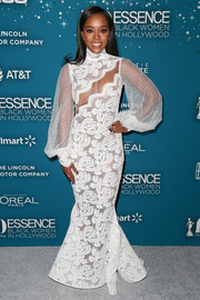 Aja Naomi King looked alluring at the Essence Black Women in Hollywood Awards in a white Michael Costello mermaid gown with a cleavage-baring panel.