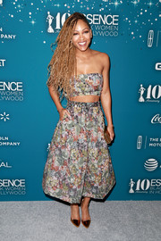 Meagan Good opted for a skimpy floral bandeau top when she attended the Essence Black Women in Hollywood Awards.