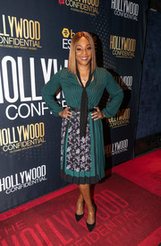 Tiffany Haddish looked demure in a floral-and-stripes tie-neck dress at the Essence Magazine and Hollywood Confidential event.