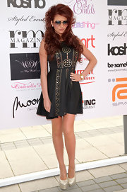 Amy Childs attended Essex Fashion Week wearing a pair of shimmering pale gold platform pumps.