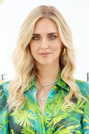Chiara Ferragni accessorized with a diamond cross pendant.
