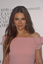 Elizabeth Hurley attended the 'Hear Our Stories' screening looking like a goddess with her flowing locks.