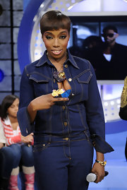 Estelle topped her jean jumpsuit off with a cool cocktail ring.