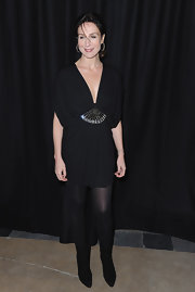 Elsa Zylberstein wore a deep-plunging LBD with a dazzling waist detail for the Etam fashion show.