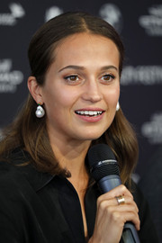 Alicia Vikander wore her hair in a neat half-up style at the Zurich Film Festival press conference for 'Euphoria.'
