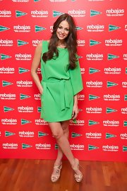 Eva Gonzales stepped out at the Corte Ingles Castellana sales campaign wearing a green one-sleeved dress.