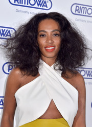 Solange Knowles pulled off bright orange lipstick at the opening of the Rimowa store in Miami.