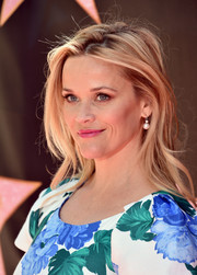 Reese Witherspoon wore her hair in a tousled layered cut at Eva Longoria's Hollywood star ceremony.