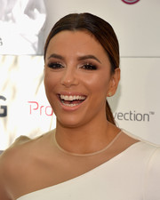 Eva Longoria finished off her beauty look with a glossy lip.