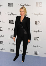 Naomi Watts stepped out in a sleek black suit, which she paired with lack leather peep-toe booties.