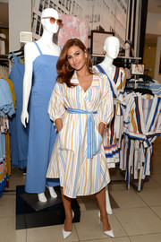Eva Mendes showed off a stylish striped shirtdress from her collection with New York & Company while visiting a store.