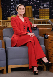 Evan Rachel Wood paired black Louboutin peep-toes with a red pantsuit for her appearance on 'Jimmy Fallon.'