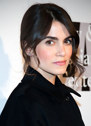 Nikki Reed kept her red carpet look casual but elegant with this bobby-pinned updo and face-framing curls.