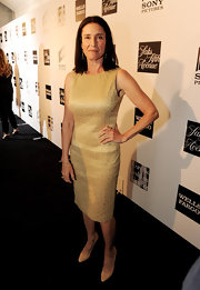 Mimi Rogers chose this gold shift dress for her red carpet look at 'An Evening' in Beverly Hills.