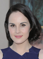 Michelle Dockery's deep brown locks looked shiny and rich when styled into a short bob.