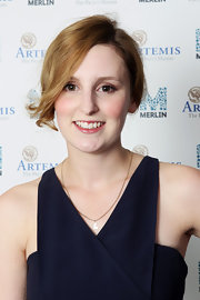 Laura Carmichael wore a simple gold chain necklace with an 'L' pendant for the charity event.