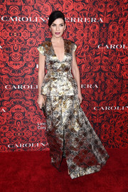 Julianna Margulies went for standout shine in a metallic peplum gown during the Evening Honoring Carolina Herrera event.