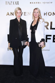 Joanna Hillman injected some shine into her all-black outfit with a metallic silver clutch.