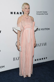 Michelle Williams was trendy and sweet in a pink cold-shoulder gown at the Evening Honoring Louis Vuitton event.