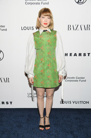 Lea Seydoux paired her cute frock with black ankle-strap sandals.