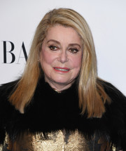 Catherine Deneuve wore her hair just past her shoulders in a straight side-parted style at the Evening Honoring Louis Vuitton event.