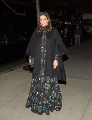Liv Tyler made a dramatic entrance at the Evening Honoring Valentino event in a black cape layered over an embroidered gown.