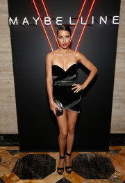 Adriana Lima sealed off her look with black broad-strap platforms.