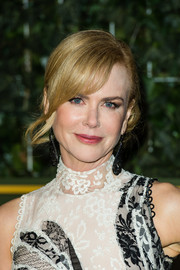 Nicole Kidman went for a demure look with this loose side bun at the Evening Standard Theatre Awards.