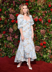 Suki Waterhouse looked ultra feminine in a puff-sleeved floral corset dress by Brock Collection at the 2018 Evening Standard Theatre Awards.