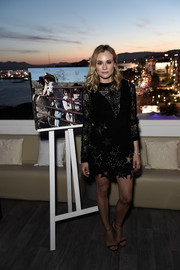 Diane Kruger made a fun and vibrant choice with this deep-V, star-embellished LBD layered over a matching sweatshirt, both by Anthony Vaccarello, for the Jaeger-LeCoultre event in Cannes.