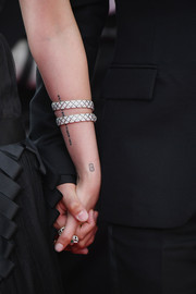Kristen Stewart has what looks like a domino tattoo on her wrist.