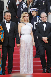 Lea Seydoux looked fashion-forward in a sheer, asymmetrical white gown by Louis Vuitton at the 2018 Cannes Film Festival opening gala.
