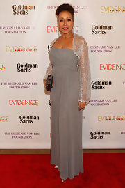 Tamara Tunie chose a gray column-style, strapless dress for her elegant and sophisticated look.