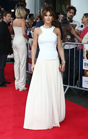 Cheryl's elegant white gown had a sporty edge at the UK premiere of 'What to Expect When You're Expecting.'