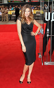 Lisa Snowdown paired her peep toe pumps with a draped black dress while walking the red carpet.