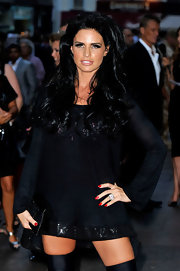 Katie Price showed off her long flowing curls while hitting the premiere of 'The Expendables'.