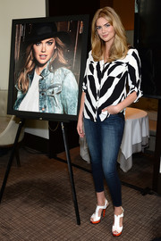 Kate Upton kept it casual yet stylish in a button-down featuring a bold zebra print during the launch of her collaboration with Express.