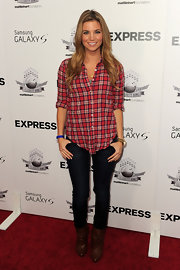 Amber went for a chic western look with a plaid button-down top, skinny jeans and scrunched leather boots.