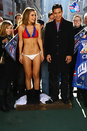 After losing a bet with Extra co-host A.J. Calloway, Maria Menounous, braved the cold NYC weather and put on a New York Giants themed bikini Monday.
