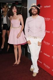 Charlotte maintained her signature quirky style in a pink tutu style dress paired with brown ballet flats.