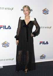 Pom Klementieff went goth in a black lace maxi dress with a contrast collar at the 'Extraordinary: Stan Lee' event.